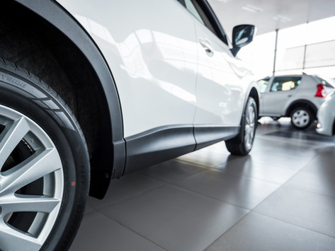 Do I need to use the Main Dealer for a service to protect my new car's warranty?