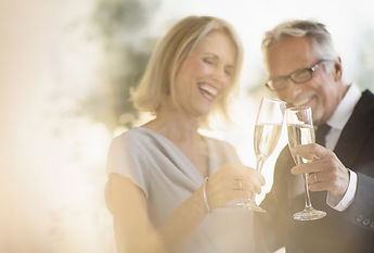 smiling-older-caucasian-couple-toasting-