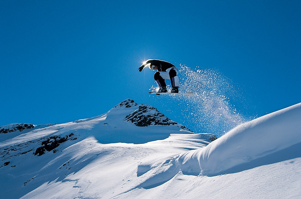 Man snowboarding at Mammoth ski resort