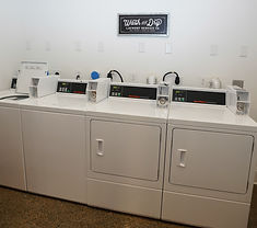 Shared Laundry room with coin-operated washers & dryers, iron and ironing board