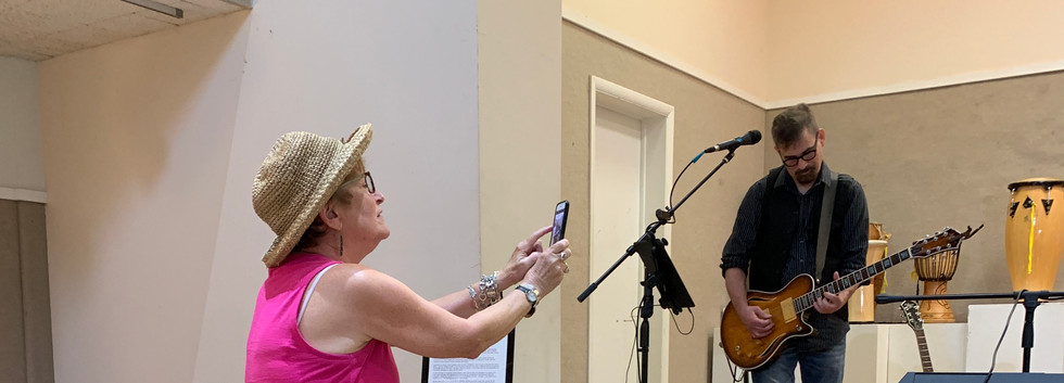 Elayne Gross capturing moments at the opening.