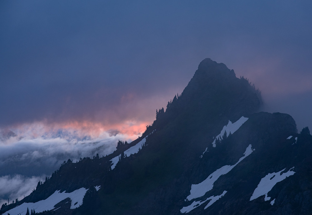 sunrise behind a mountain peak