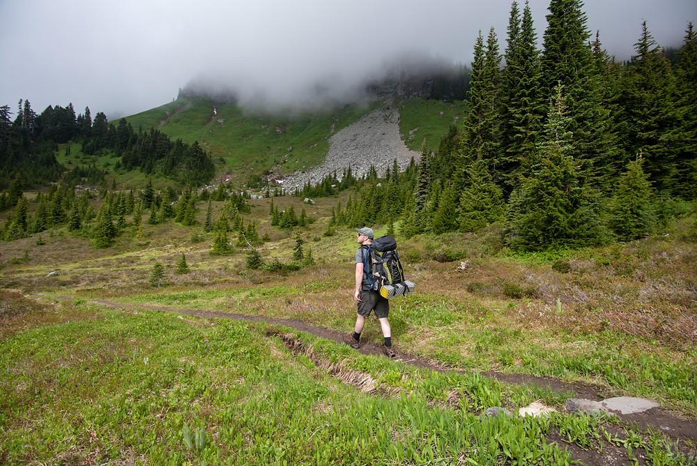 Green meadows below church mountain