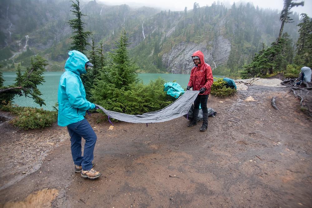 Hikers setting up tent upper watson lake
