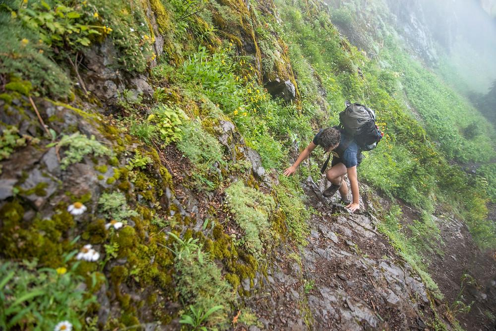 Hiker going up slick rock surface