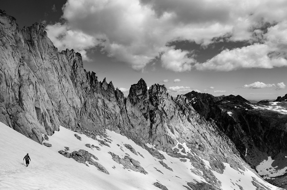 A climber descends Dragontail Peak in the Enchantments