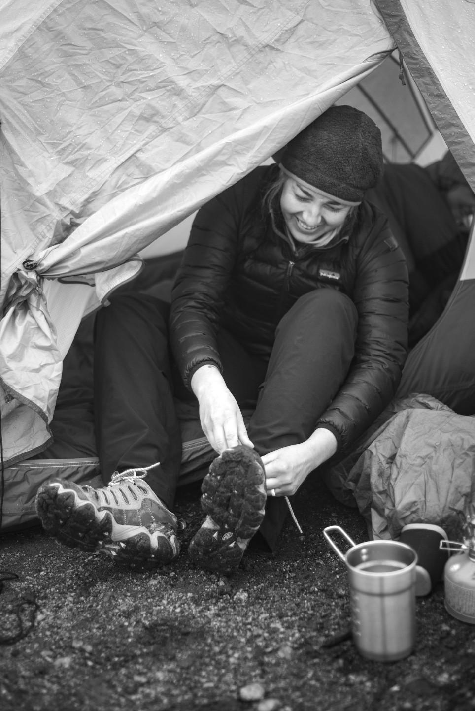 Megan tying shoe