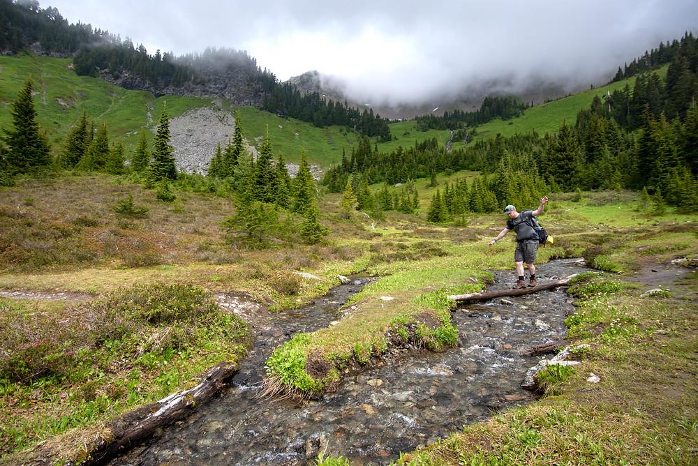 Church mountain creek log balancing act