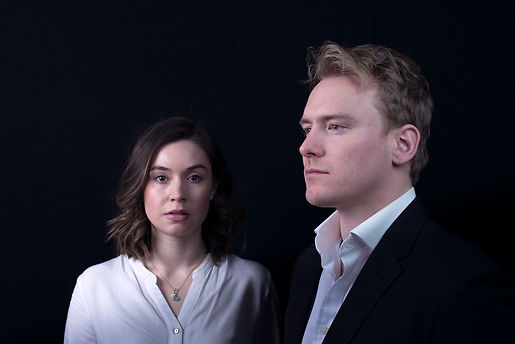 portrait photo of two actors against a black background