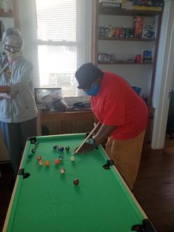 Carol and Lisa Shooting Pool 2