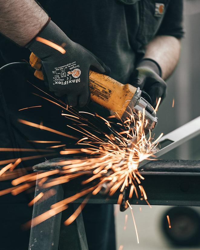 man welding metal