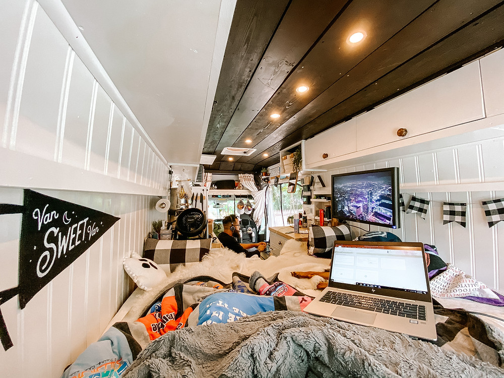 Vanlife interior with laptops and computer screen