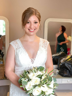 Glowing bridal makeup. The bride Emily