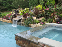 Raised Spa and Waterfall over a Pool