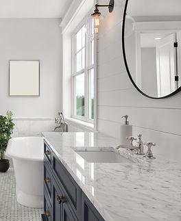 Beautiful Ensuite Master Bathroom in New Luxury Home. Features Elegant Countertop, Bathtub