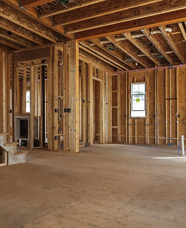 interior frame of a new house under construction.jpg