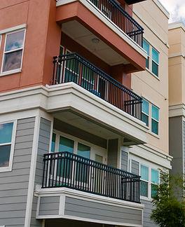 Modern luxury urban apartment building exterior with blue sky..jpg