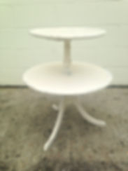White vintage side table for rent for weddings and events in New Orleans.