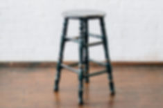 Vintage leather stool for rent for weddings and events in New Orleans.