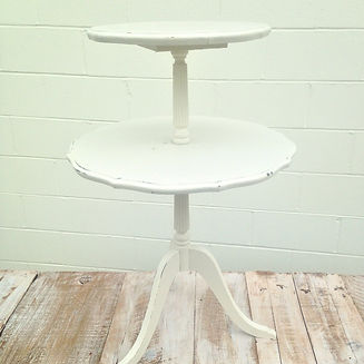 Vintage white side table for rent for weddings and events in New Orleans.