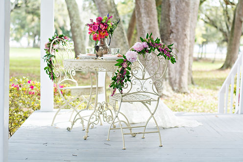 Cream bistro table and chairs  for rent for weddings and events in New Orleans.