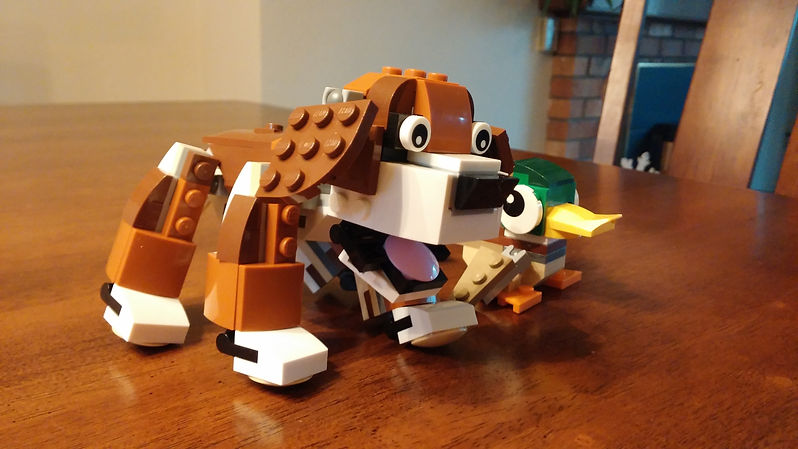 Lego dog and Lego Duck on table