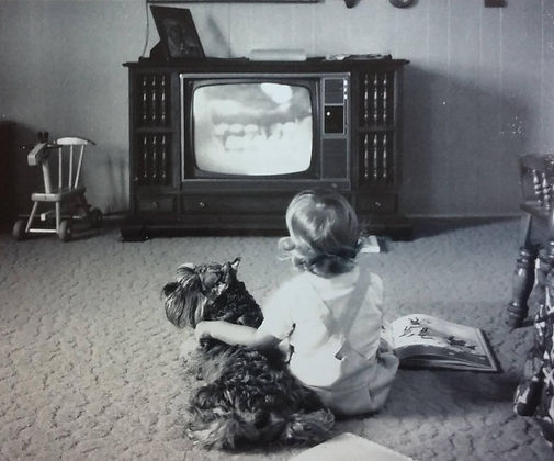 black & white retro picture with dog and child watching TV