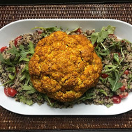 Roasted cauliflower over quinoa & arugula salad