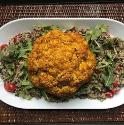 Roasted cauliflower over quinoa & arugula salad