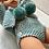 Thumbnail: Boneca com casaco e tapa-fraldas azul água com pompons verde