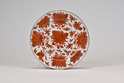 Dish with painted decoration of flowers in gold and red glazes
