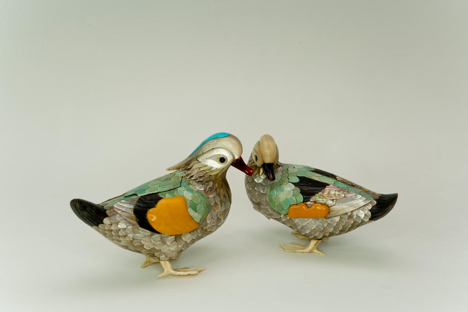 A pair of mandarin-duck-formed boxes and covers inlaid with various precious materials