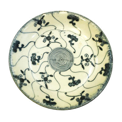 Dish with fungi and floral sprays