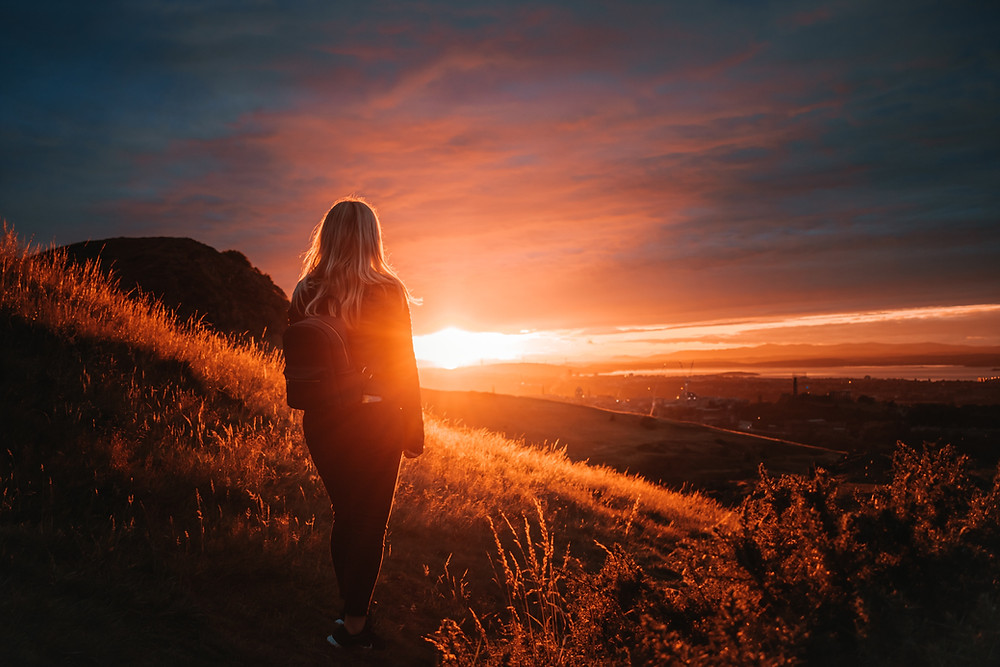 Woman looking at sunrise