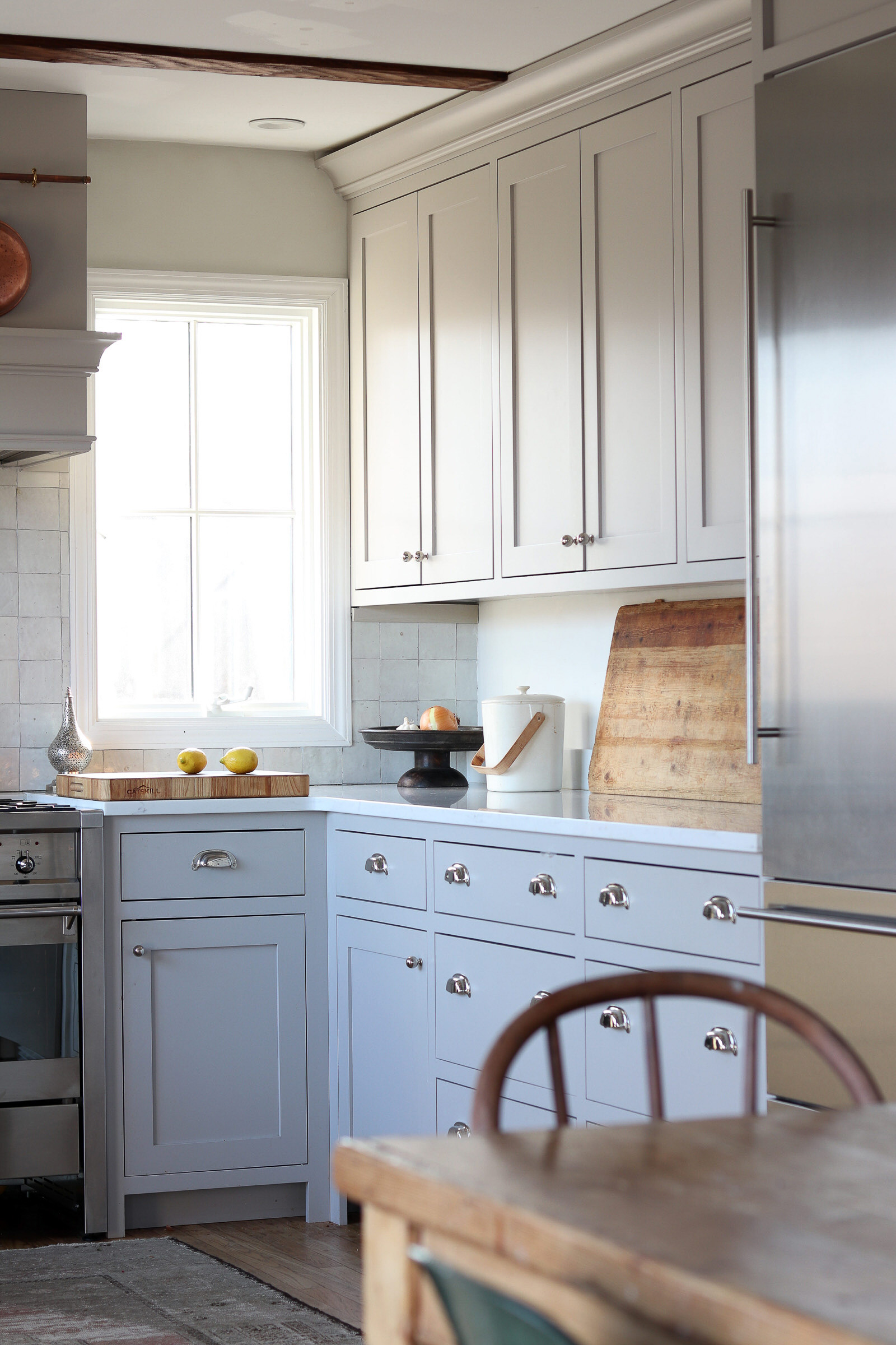 gray farmhouse kitchen with nickel hardw