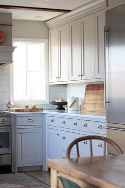 gray farmhouse kitchen with nickel hardw
