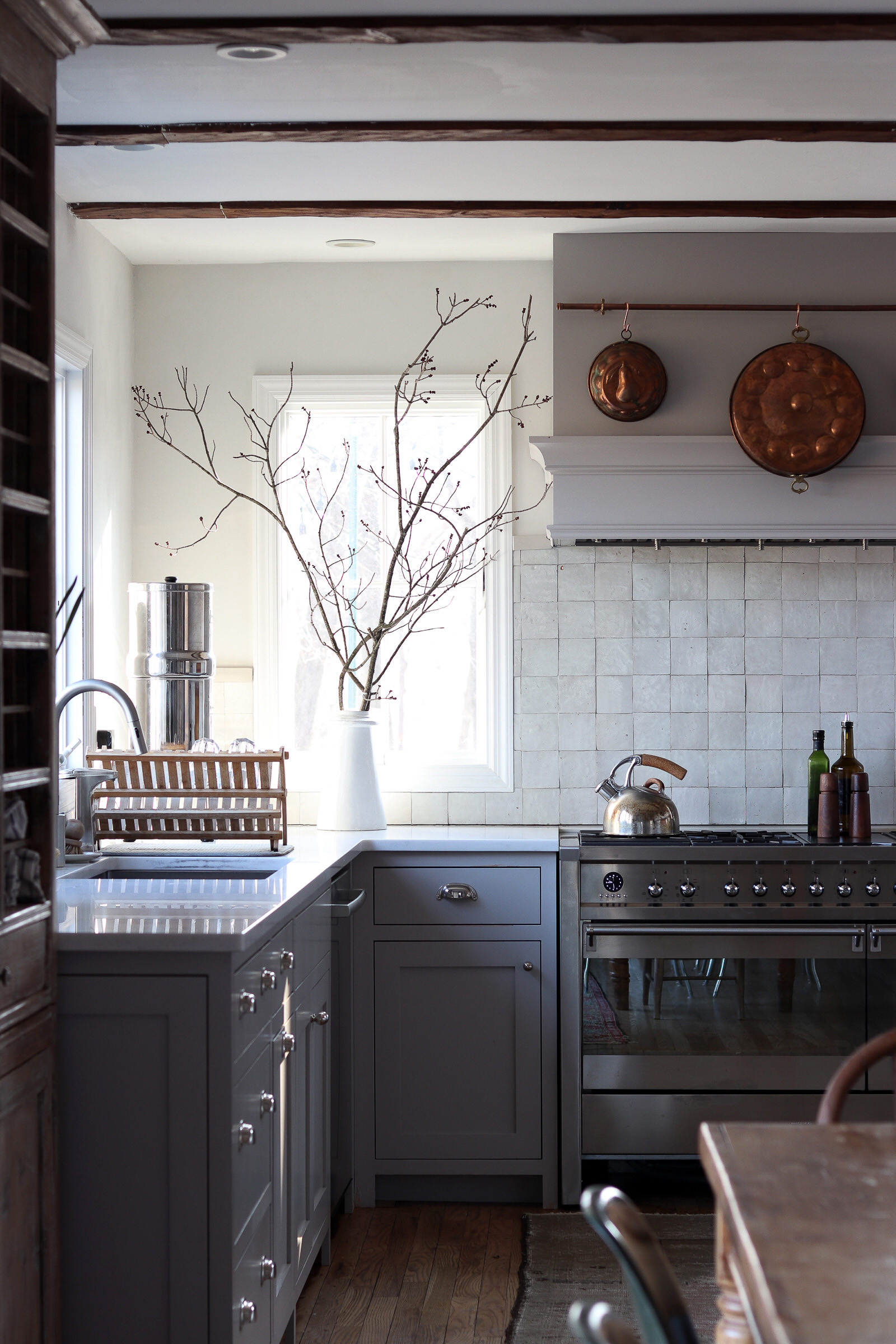 farmhouse kitchen with inset gray  cupbo