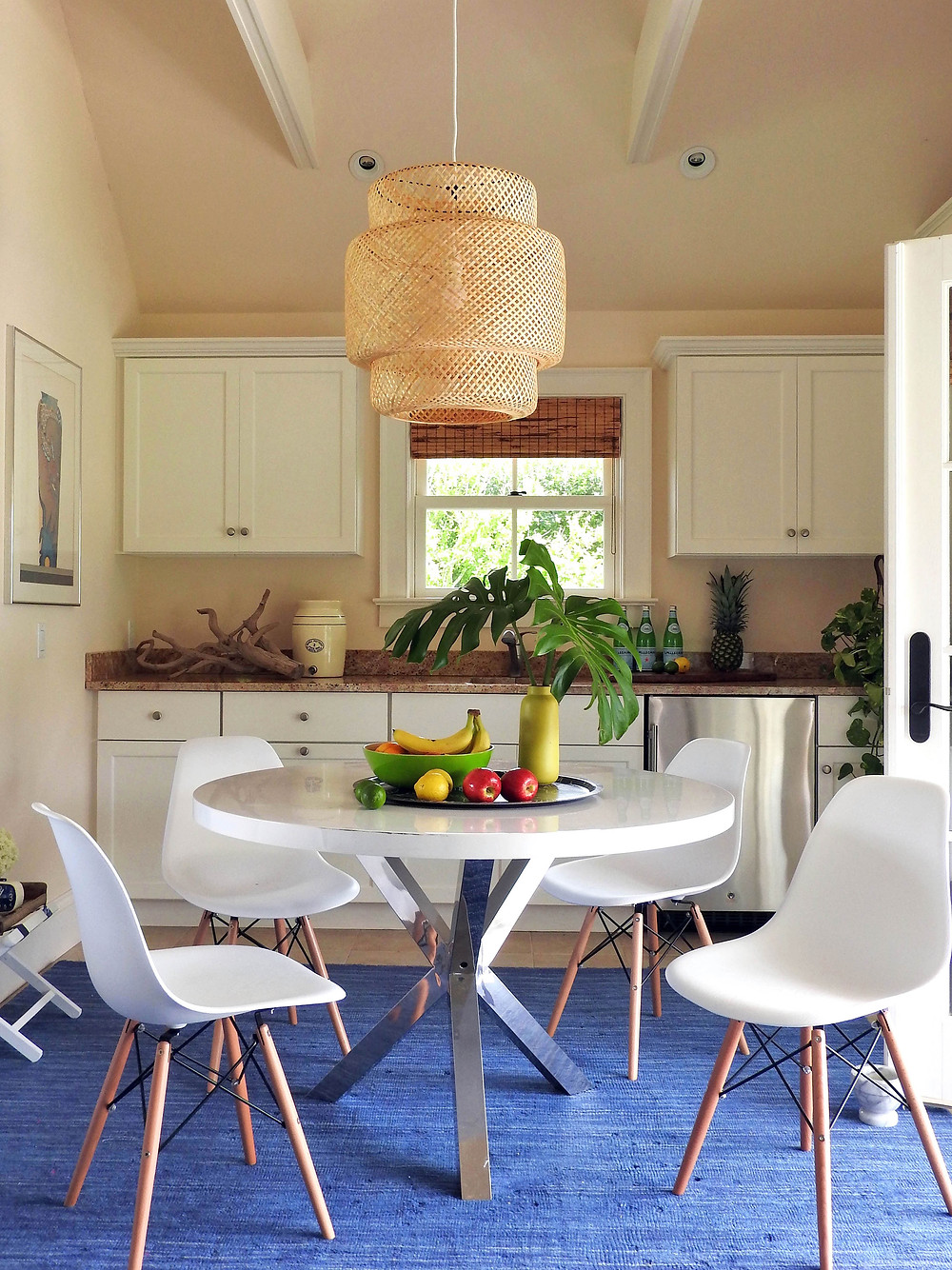 white dining table with shell chairs