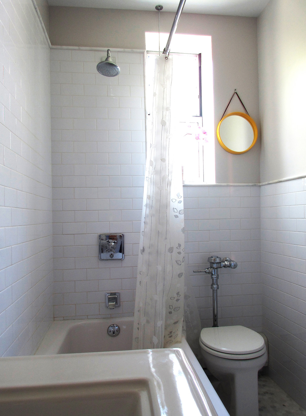 white subway tiles in grey bathroom