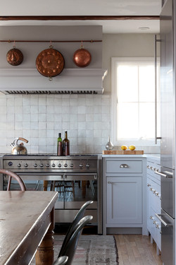 gray kitchen with farm table in european
