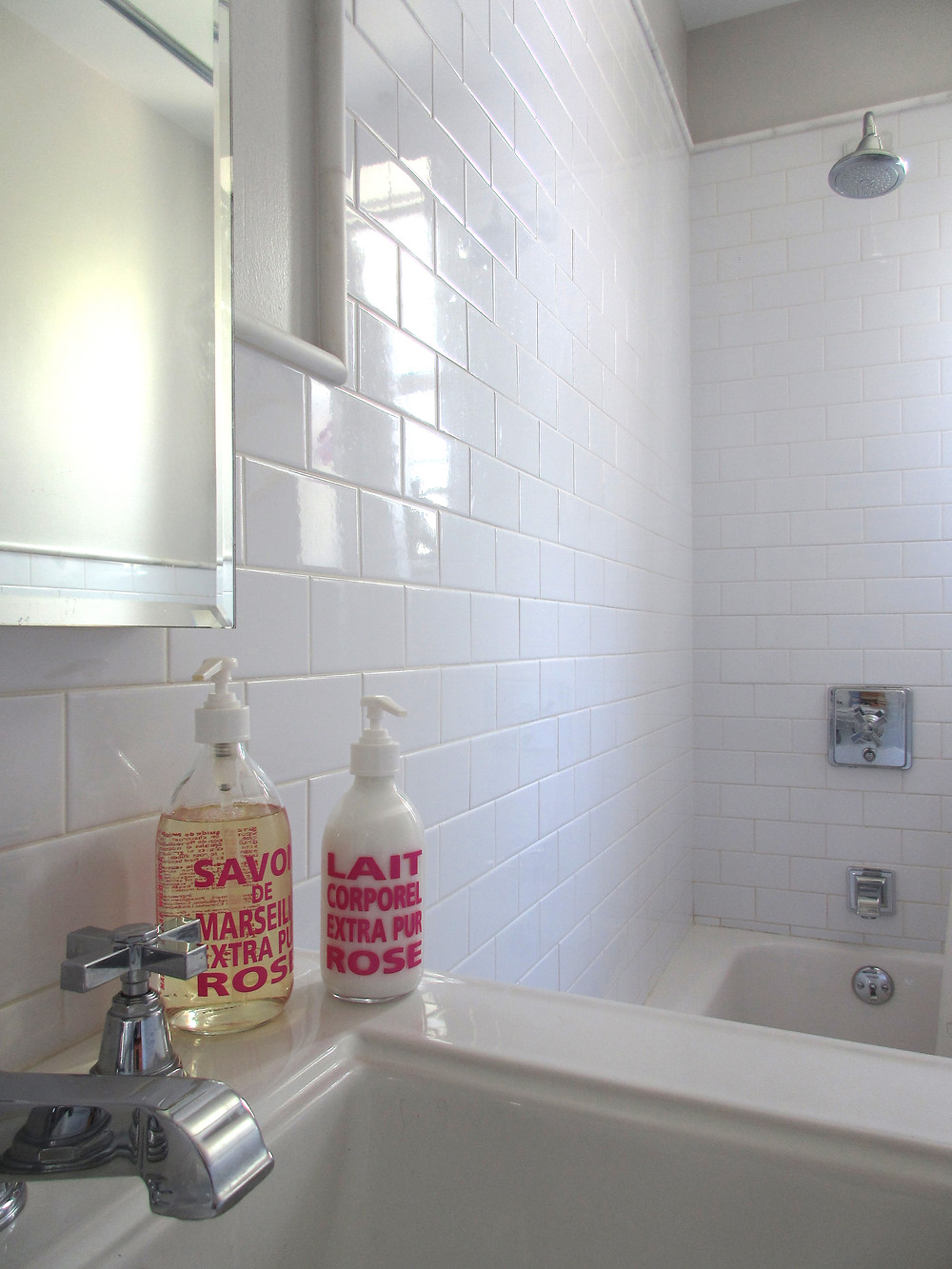 white subway tiles with marble trim in bathroom