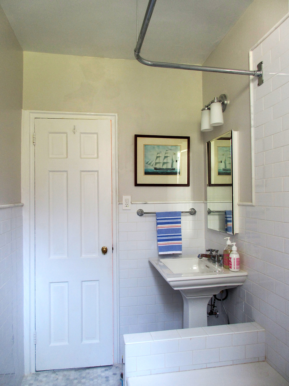 grey bathroom with white subway tiles