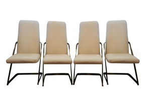 Brass cantilever chairs