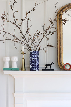 branches on fireplace mantel