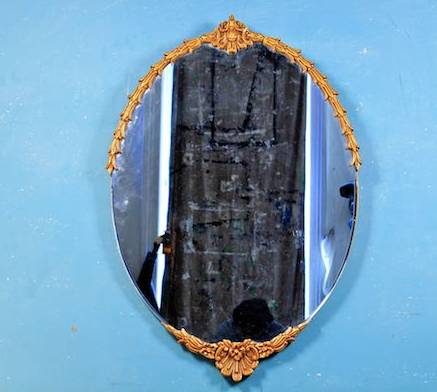 French Nouveau oval mirror