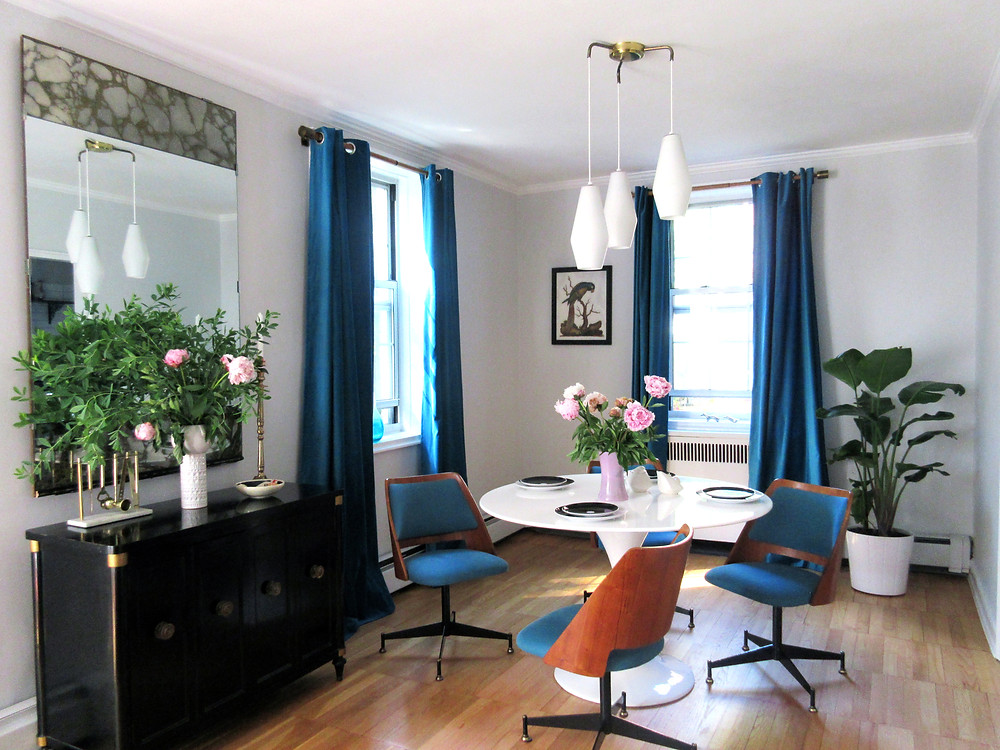 blue mid century modern chairs in dining room