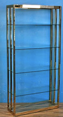 gold bookshelf with glass shelves