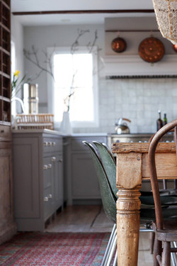 pine farm table in rustic kitchen