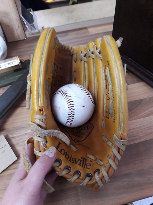 Louisville Slugger Mitt and baseball