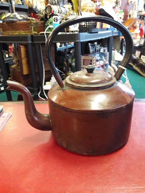 Large metal kettle.